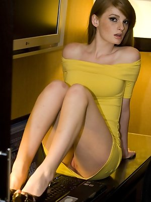 Faye Reagan strips her yellow dress baring her smoking hot body, yummy tits and pink pussy on the chair.